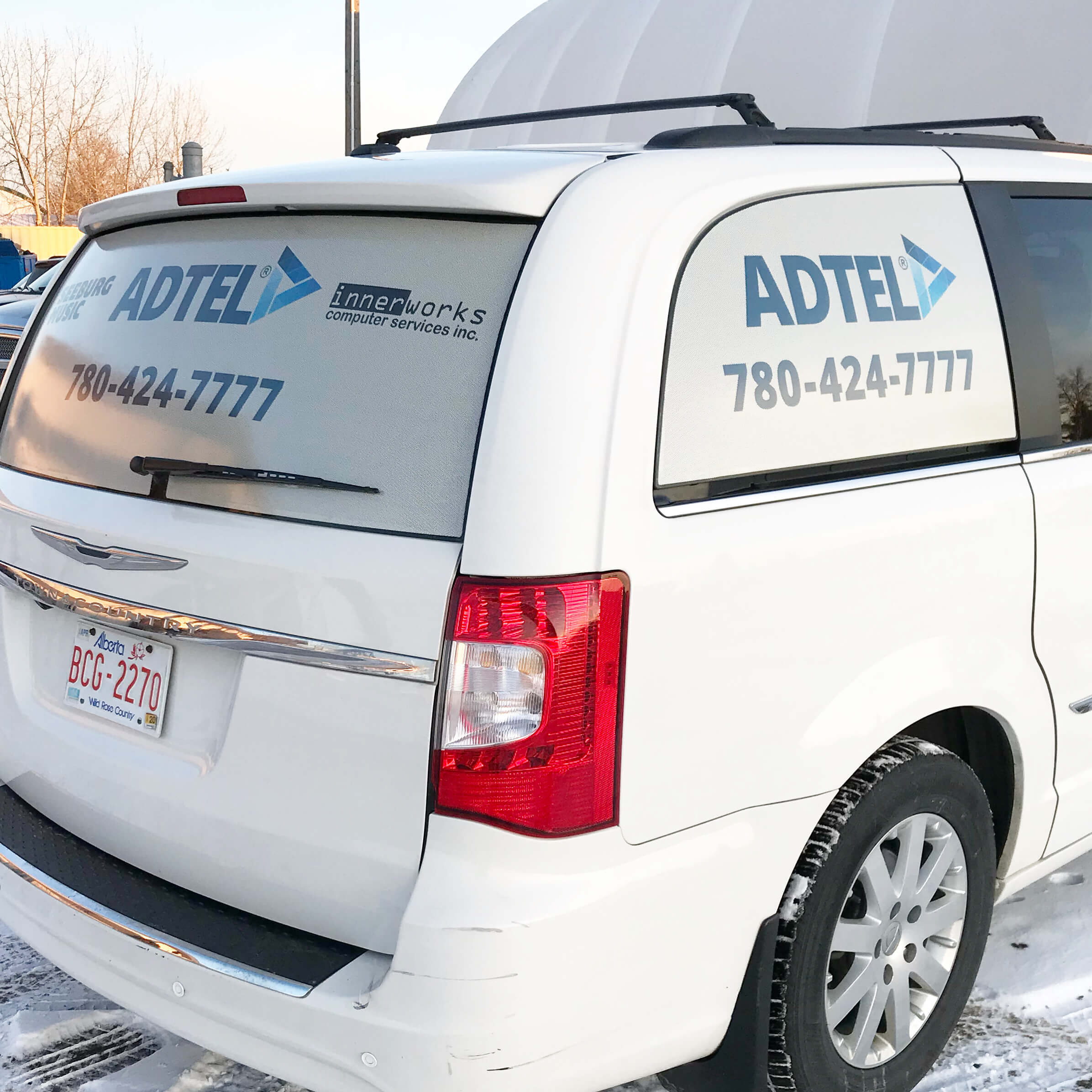 ADTEL commercial vehicle wraps for advertisement in Edmonton, AB